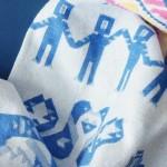 Бебешко одеяло от 100% био памук с мотиви от различни етнографски региони на България 'ШЕВИЦА'